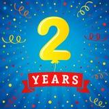 2 ans de célébration d'anniversaire avec le ballon et les confettis colorés Photos stock