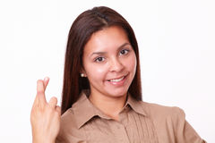 20-24 ans de fille hispanique avec le signe de chance Photographie stock libre de droits