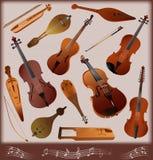 Ansammlung Musikinstrumente strunnych smychk Stockfotos