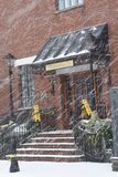 Ansborough Inn, Charleston, SC. A freak winter storm dumps over 6 inches of snow in Charleston, SC. The entrance to the Ansborough Inn in downtown is completely royalty free stock photos