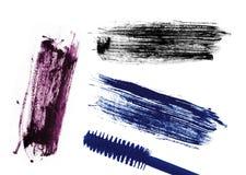 Anschlag (Probe) der blauen, violetten und schwarzen Wimperntusche, lokalisiert Stockfotos