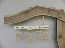 Anschlagtafelpizza Stockfoto