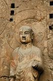Anscient Buddhist cave statue. Stock Photos