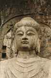 Anscient Buddhist cave statue. Royalty Free Stock Photo