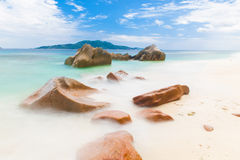 Anse Gaulettes. Beautifully shaped granite boulders and a perfect white sand at Anse Gaulettes, La Digue island, Seychelles. Long exposure Royalty Free Stock Photography