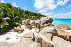 Anse Patates. Beautifully shaped granite boulders and a perfect white sand at the Anse Patates beach, La Digue island, Seychelles Royalty Free Stock Photo