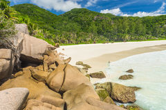 Anse Petite. Beautiful and a famous beach Anse Petite seen from the granite boulders, La Digue island, Seychelles Royalty Free Stock Image