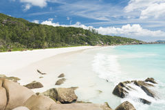 Anse Petite. Beautiful and a famous beach Anse Petite seen from the granite boulders, La Digue island, Seychelles Stock Photos