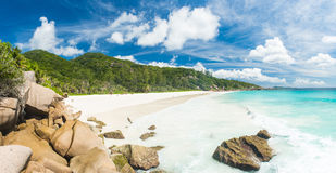 Anse Petite. Beautiful and a famous beach Anse Petite seen from the granite boulders, La Digue island, Seychelles. Panorama Royalty Free Stock Photography