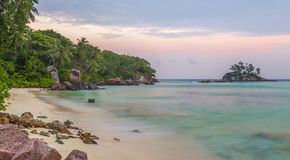 Anse Royale at sunset sandy beach on Mahe Seychelles.  Royalty Free Stock Photos
