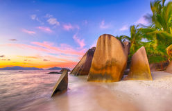 Anse Source d'Argent. Beautifully shaped granite boulders and a dramatic sunset  at Anse Source d'Argent beach, La Digue island, Seychelles Stock Images