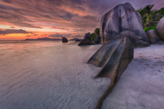 Anse Source d`Argent. Beautifully shaped granite boulders and a dramatic sunset  at Anse Source d`Argent beach, La Digue island, Seychelles Stock Photography