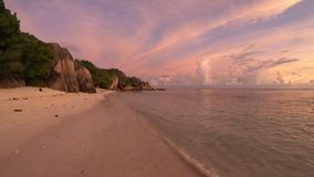 Anse Source d`Argent at dusk. Dramatic colorful sky dusk at scenic Anse Source d`Argent in Seychelles, La Digue. Landscape with shaped rock stone of granite and stock footage