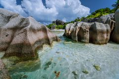Anse Source d`Argent one of the most beautiful beach on the world. Huge granite boulders, shallow blue lagoon and stock photography