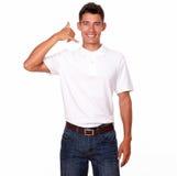 Anseende för ung man och le med ett appelltecken. Arkivbilder
