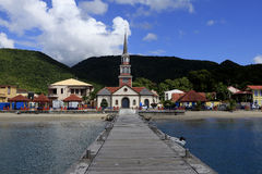 Anses d'arlet village, Martinique, west indies. Famous church and jetty of Anses d'arlet village, Martinique, west indies royalty free stock images