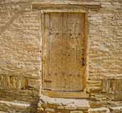 The ansient door. The old carved wooden door leads to the old house in Itchan Kala, Khiva, Uzbekistan stock images