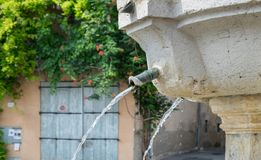 Ansient fountain in Riez. Alpes-de-Haute-Provence region. France royalty free stock photo