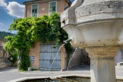 Ansient fountain in Riez. Alpes-de-Haute-Provence region. France royalty free stock photography