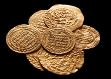 Ansient golden islamic coins isolated on black Royalty Free Stock Photo