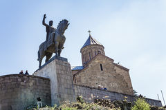 Ansient monument in Tbilisi. Monument to Tsar Vakhtang Gorgasal near the ancient fortress of the 13th century in Tbilisi, Georgia. April 17, 2015 stock images