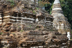 Ansient stupa and white lion. HSIPAW, MYANMAR - CIRCA APRIL 2017 Stupa in Maha Nanja Kantha Monastery royalty free stock photography