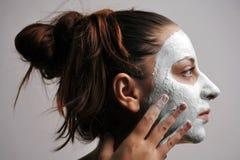 ansikts- maskering Arkivbilder