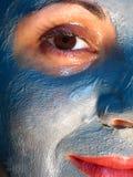 ansikts- maskeringsleende Arkivfoto