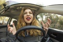 Ansiktsuttryck för bilkrasch Arkivbild