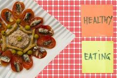 Ansjovis, tomaat en olijven stock afbeeldingen
