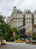 The Ansonia building and taxi on the street Royalty Free Stock Images
