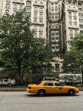 The Ansonia building and taxi on the street Royalty Free Stock Image