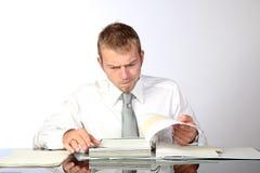 In Anspruch genommen, Dokumente wiederholend Lizenzfreie Stockbilder