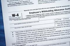 Anställds för form W-4 undanhålla certifikat för avdrag arkivbilder