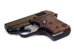 Anstellen der Pistole auf Weiß Lizenzfreie Stockfotografie