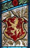 Anstränga-exponeringsglas fönster - Lion Banner Sigil Arkivfoton
