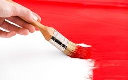 Anstrich mit roter farbiger Tinte und Pinsel Stockfoto