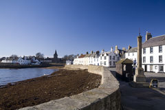 Anstruther. Coastal town in Fife, Scotland. A typical quaint coastal village, with bright blue sky Royalty Free Stock Image