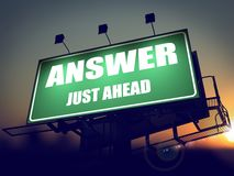 Answer Just Ahead on Green Billboard. Stock Image