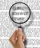 Answer. Magnifying glass over a newspaper or book classified section with answer text stock photos