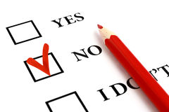 Answer No. Red pencil and selected tick box with answer No royalty free stock image
