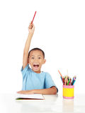 Answer the question. Confident little schoolboy lift up his hand to answer the question royalty free stock photography