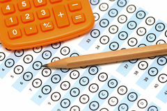 Answer sheet test score with pencil calculator Royalty Free Stock Photos