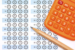 Answer sheet test score with pencil calculator Royalty Free Stock Photo