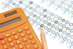 Answer sheet test score with pencil and calculator Royalty Free Stock Photos