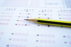 Answer sheets with Pencil drawing fill to select choice. Education concept royalty free stock images