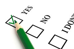 Answer Yes. Green pencil and selected tick box Royalty Free Stock Photography