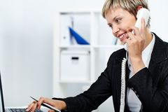 Answering a call Royalty Free Stock Image