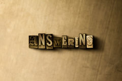 ANSWERING - close-up of grungy vintage typeset word on metal backdrop. Royalty free stock illustration. Can be used for online banner ads and direct mail vector illustration