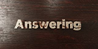 Answering - grungy wooden headline on Maple - 3D rendered royalty free stock image. This image can be used for an online website banner ad or a print postcard vector illustration